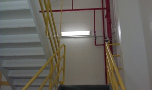 TMI cleaned and paint seven stories of a mill stairwell including the ceilings, walls and steps.