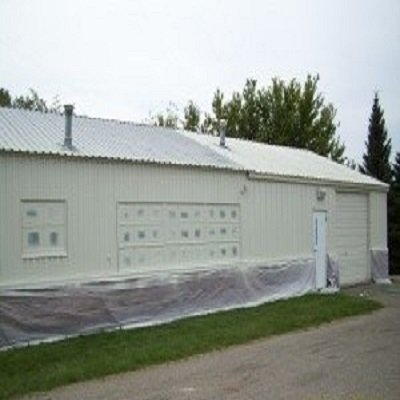Fixing a Leaky Corrugated Metal Roof during the painting and repairing process.