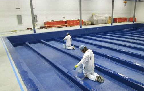 completed FIBERLIFE coating on the interior of a large concrete containment pit