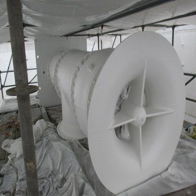 A large white fan demonstrates the sandblast and coating fans services that TMI Coatings provides.