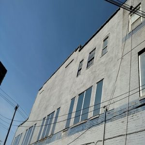Brick Building Facade Repaired With Stucco
