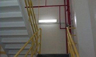 Mill Stairwell After TMI Coatings Painted It.