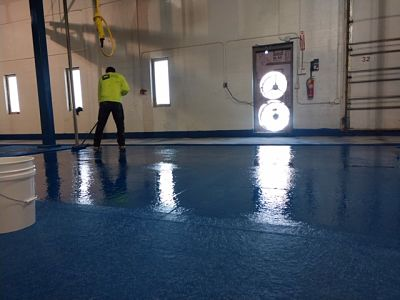 Metal Fabrication And Plating Company Industrial Flooring Being Laid Down By TMI Coatings.